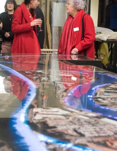 Image of two business people chating at a corporate drinks reception to illustrate corporate event photography in Bristol UK