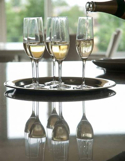 image of champagne glasses at a corporate dinner to illustrate corporate events photography in Bath UK