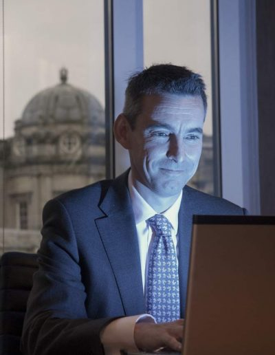 Image of a businessman at a laptop computer to illustrate corporate documentary photography in wiltshire UK