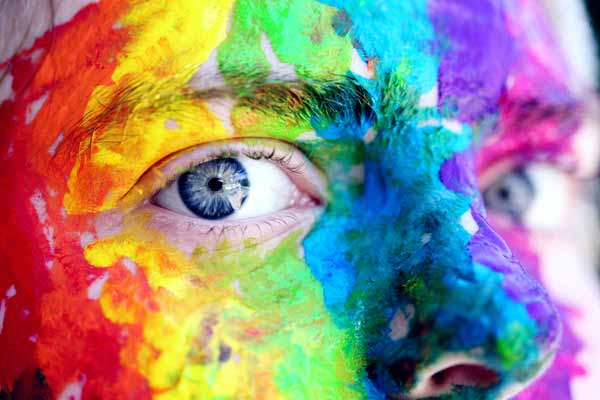 Image of a face splattered with colour to illustrate the creative ways that I build websites with photography and copywriting near Bath UK